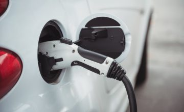 Close up car being charged with electric car charger